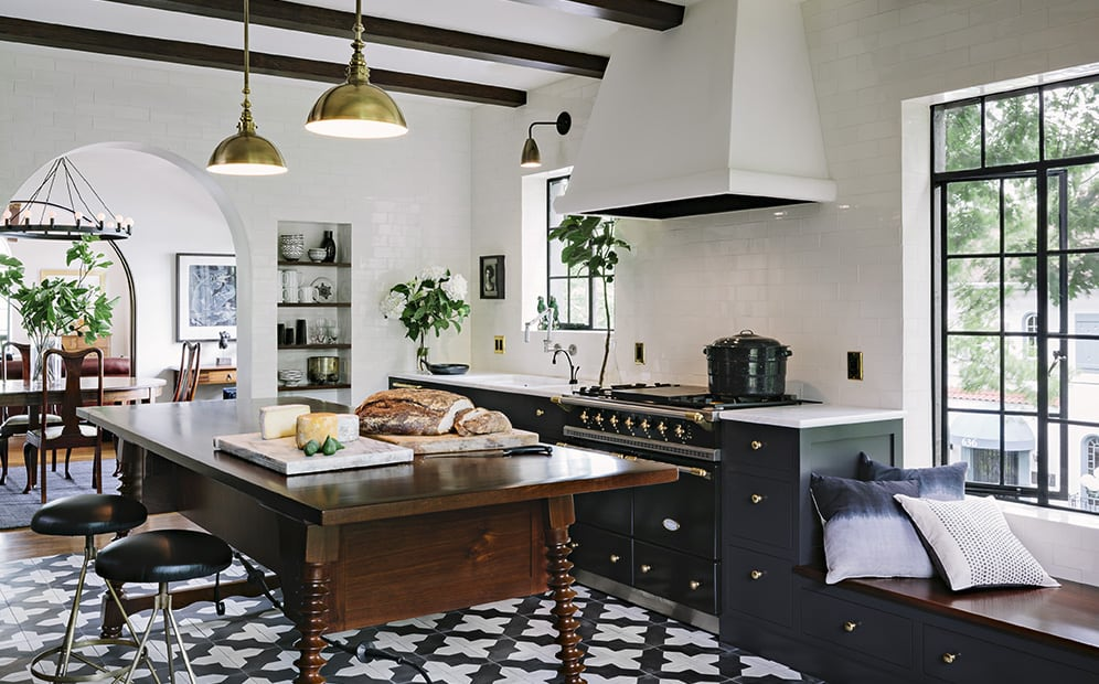 Striking kitchen, recessed shelving, tile wall, stunning, handbuilt walnut table used as an island