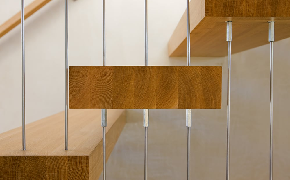 stair treads suspendid with steel rods